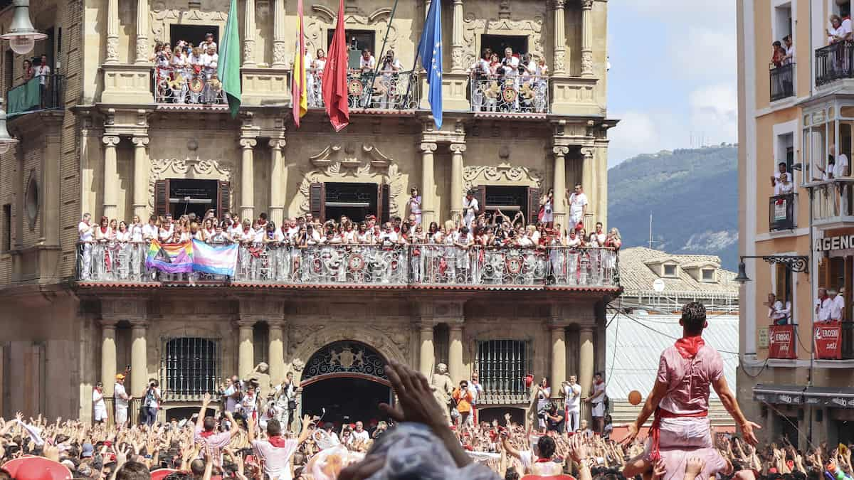 Crowds wait for the start of the San Fermines festival outside the town hall in Pamplona, Spain