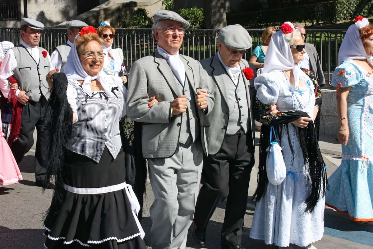 Group of people dressed in traditional costumes from Madrid at a local festival