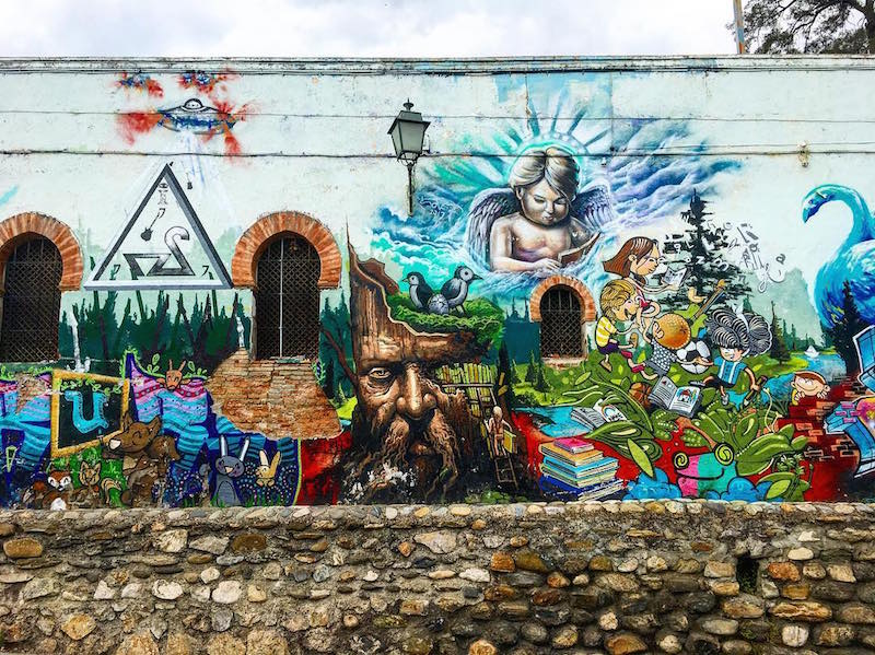 The Realejo neighborhood is home to some of the best street art in Granada, including this stunning mural outside Colegio Santo Domingo!