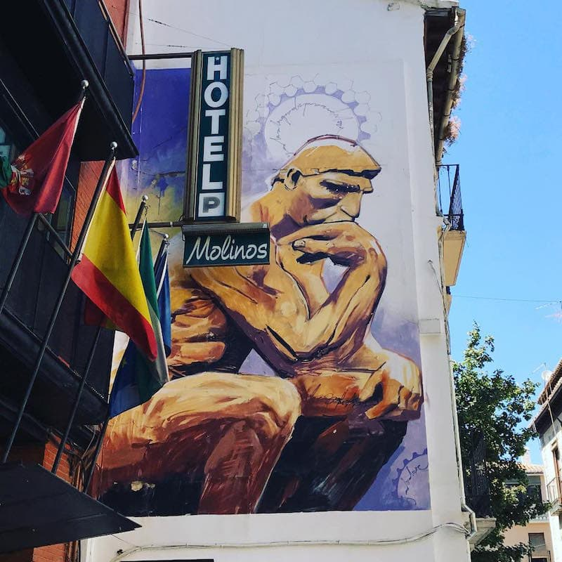 The street art in Granada is breathtaking, especially this incredible depiction of The Thinker on the side of Hotel Molinos!
