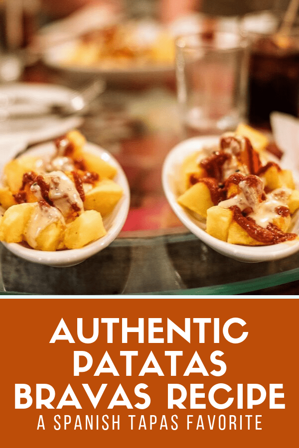 When it comes to authentic tapas from Spain, you can't get any more typical than patatas bravas. As a bonus, they couldn't be more simple to make! This easy patatas bravas recipe is a must for your next Spanish-style dinner or tapas party. #tapas