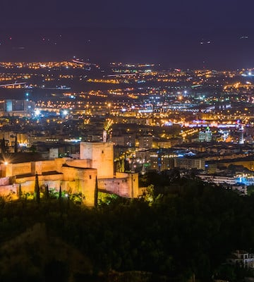 Some of the best views of Granada—like this one from San Miguel Alto—look even better at night!