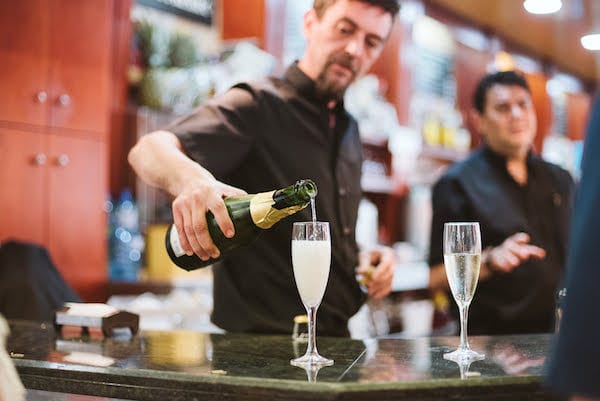 Take some time to relax and enjoy a glass of cava at the Mercado de Merced during your 10 days in Malaga—after all, you're on vacation!