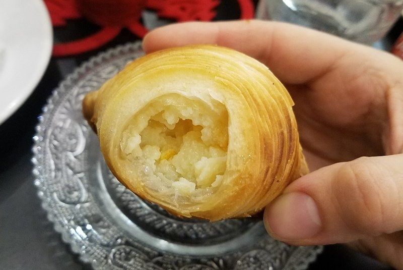 Inide the sfogliatella riccia in Naples - Must try foods in Naples