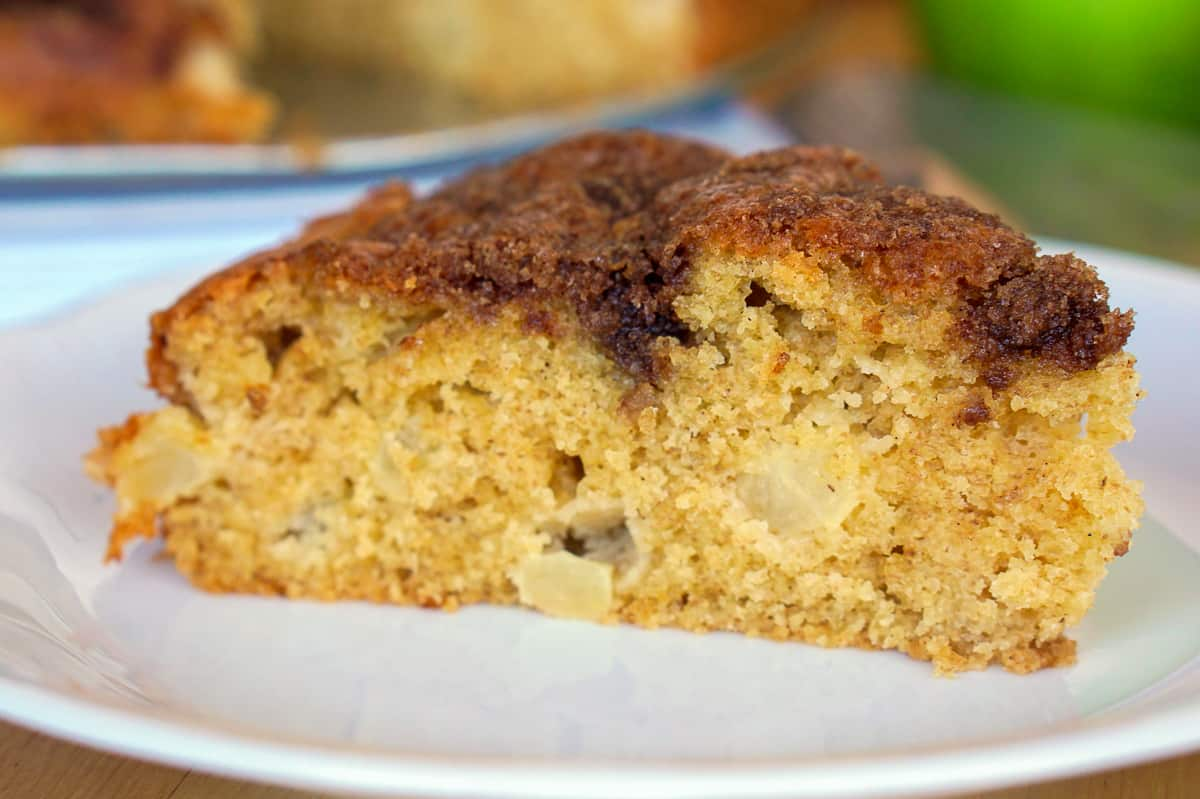 close up of a slice of apple olive oil cake