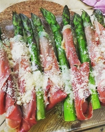 A delicious ham wrapped asparagus recipe with Manchego cheese on top!