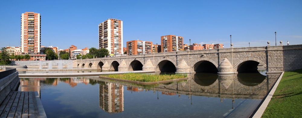 Start your walking tour of Madrid by crossing the Segovia Bridge.