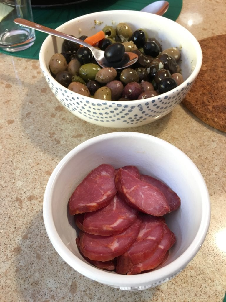 Caldo verde is best accompanied by high-quality chouriço and olives, pictured.