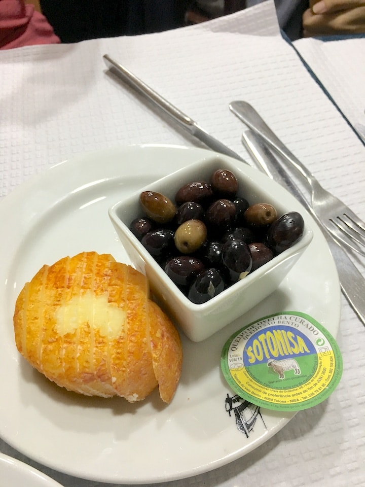 Delicious cheese and olives on a food tour in Lisbon.