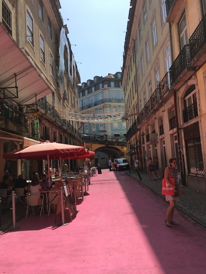 Our food tour in Lisbon went through the famous Pink Street, pictured.