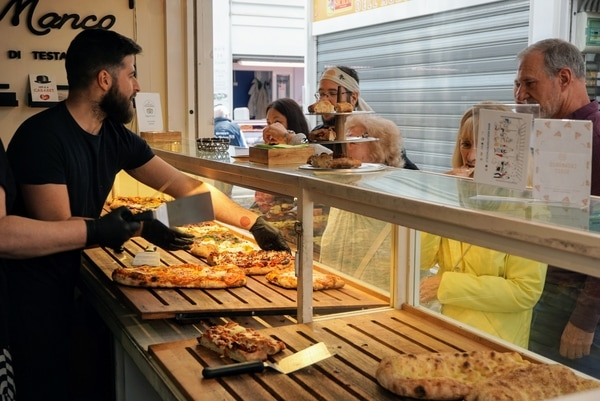 The best food tours in Rome will help you meet the people behind the food, such as your local pizza vendor.