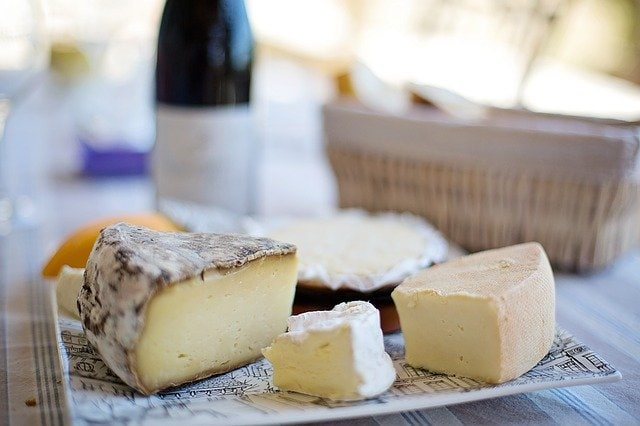 different types of cheese on a Paris food tour