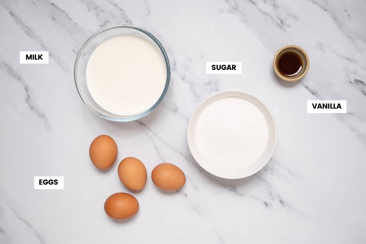 Spanish flan ingredients on a white marble counter