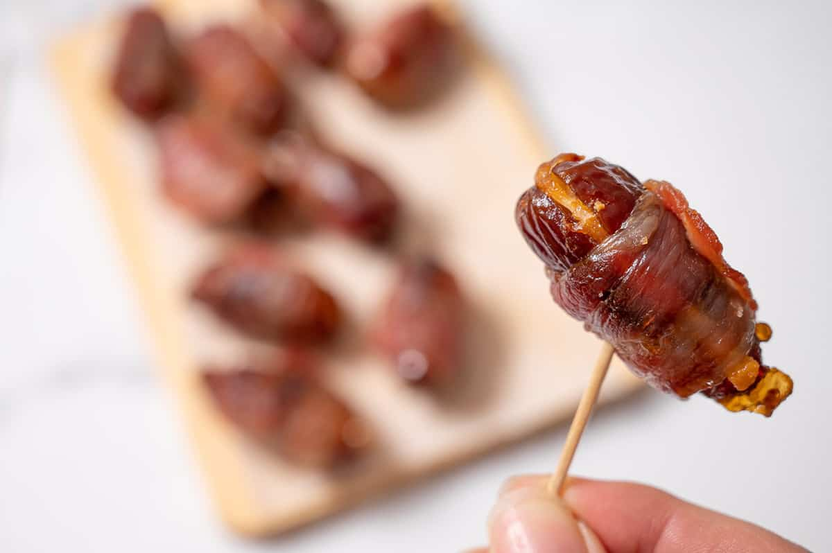 Stuffed Bacon wrapped date on a toothpick