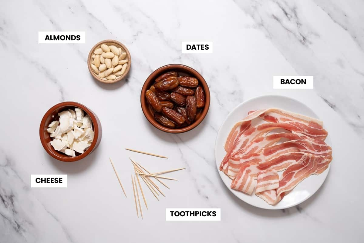 Bacon wrapped dates ingredients on a white marble countertop