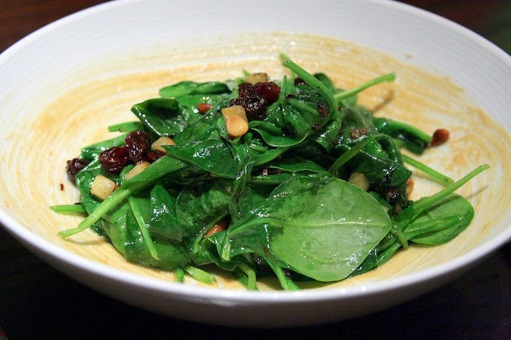 Sauteed spinach with pine nuts and raisins
