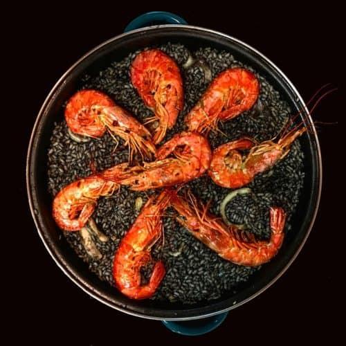 black paella in the pan