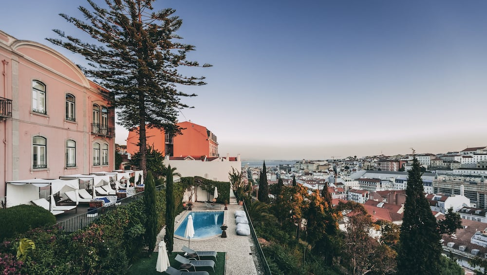 View of the pool area and city from the Torel Palace in Lisbon
