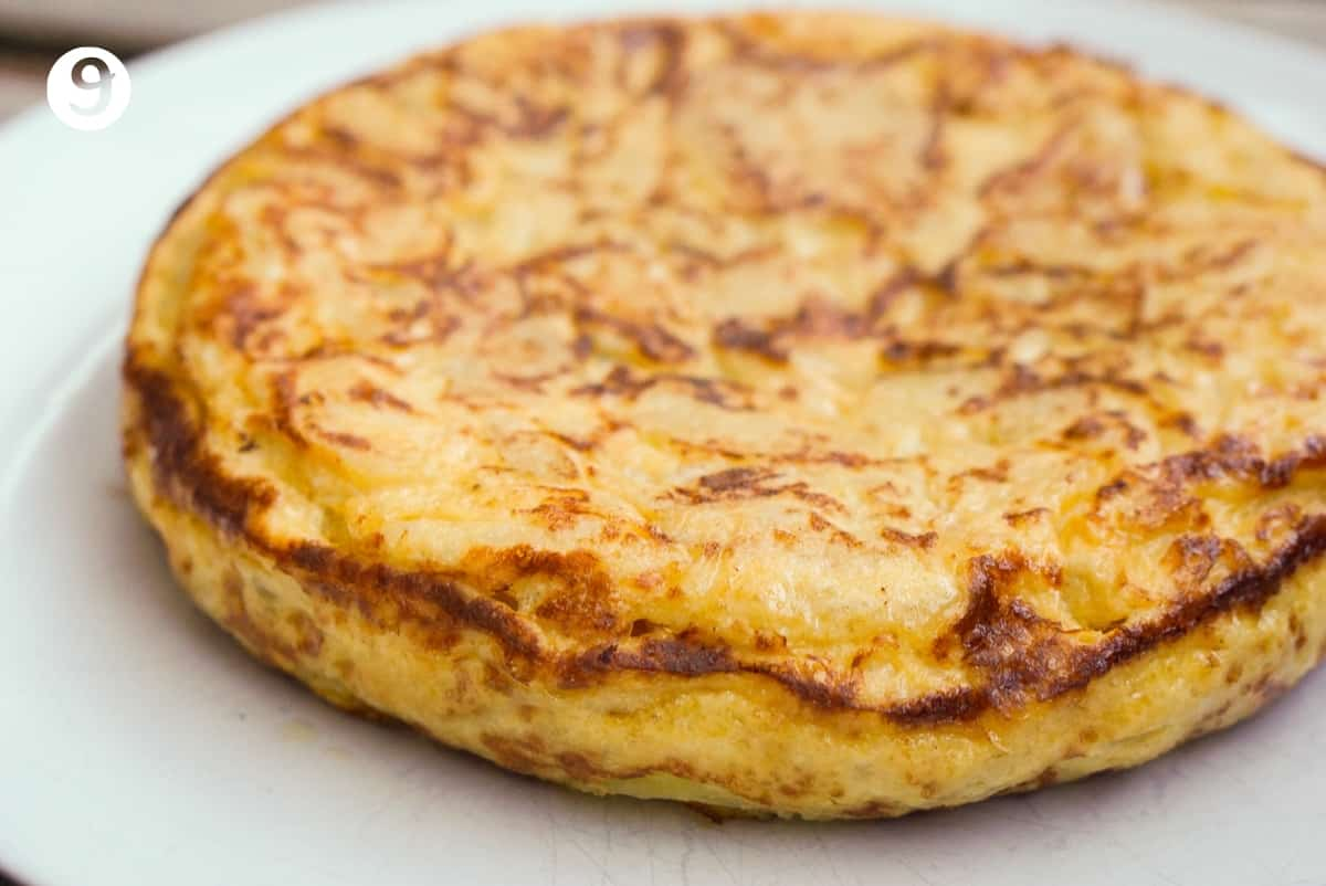 Full Spanish omelet on a white plate.