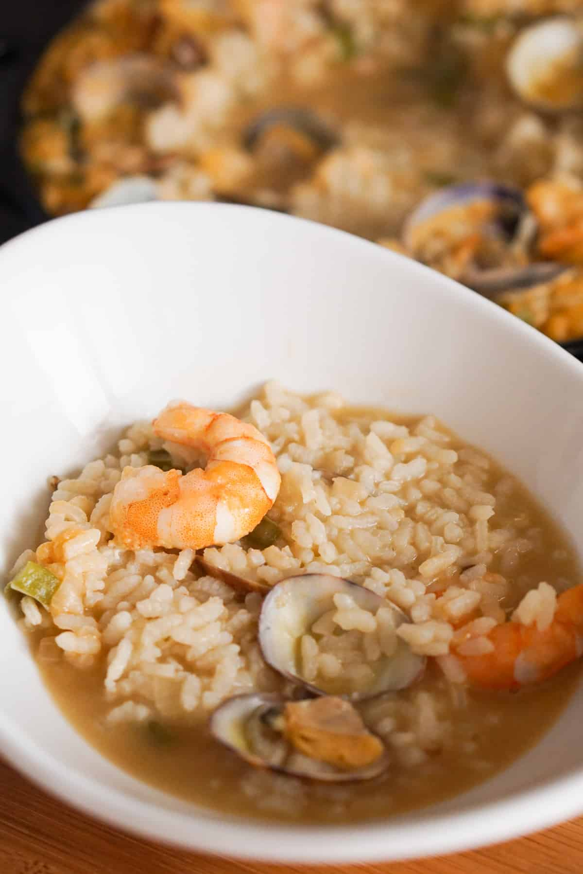 Spanish seafood rice in a white bowl.
