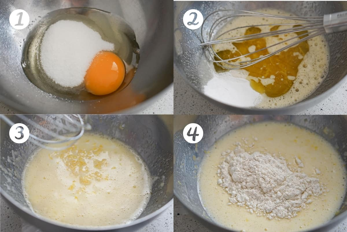 Fried donuts recipe steps 1-4 in a grid. Step 1 a metal bowl filled with egg and sugar. Step 2 a metal bowl filled with batter covered with baking powder and oil with a metal whisk on top. Step 3 a metal bowl with a batter and lemon zest on top. Step 4 a metal bowl with a batter and flour on top.