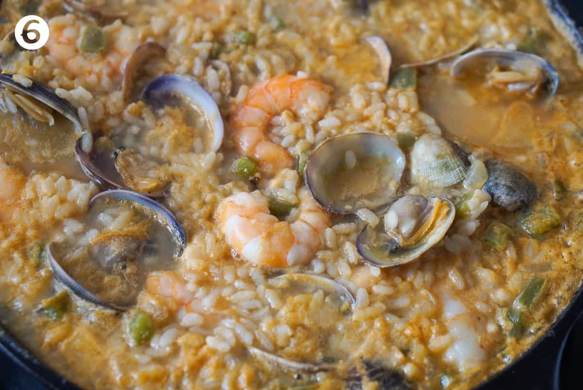 Spanish seafood rice in a cast iron pan.