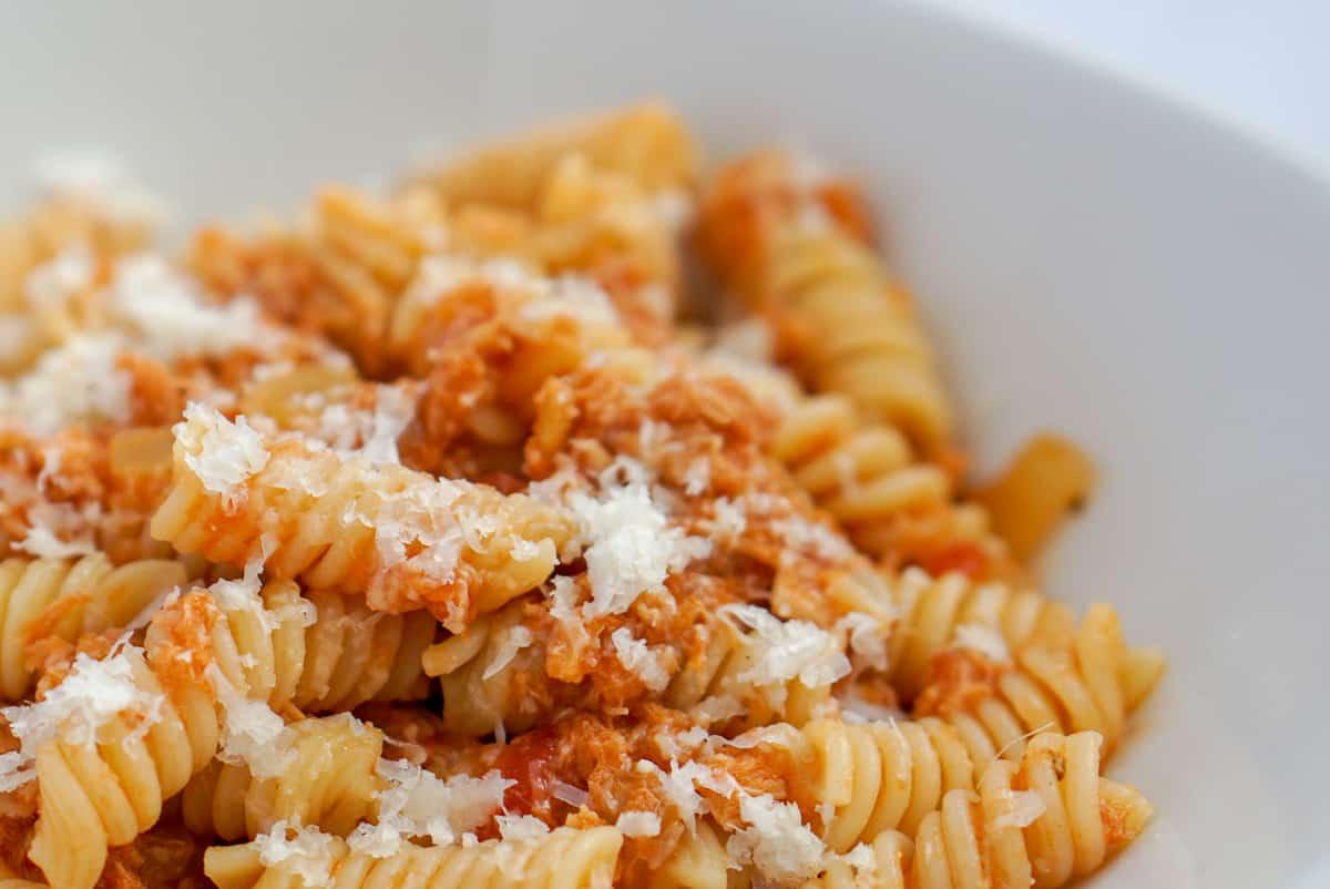 Close up of tuna pasta on a white dish.