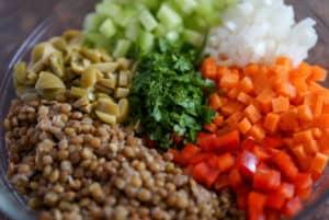 Diced veggies in a clear bowl.