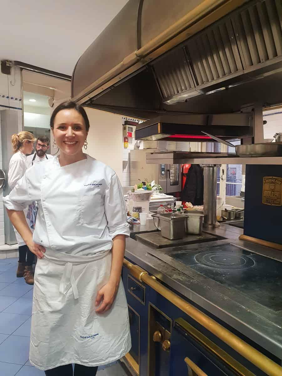 Lauren Aloise in a culinary school kitchen