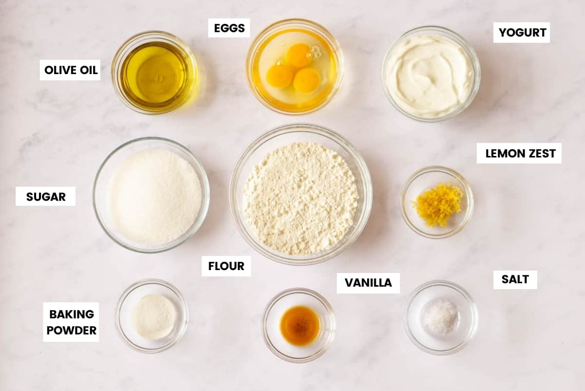 Ingredients for lemon yogurt cake with text labels for each ingredient.