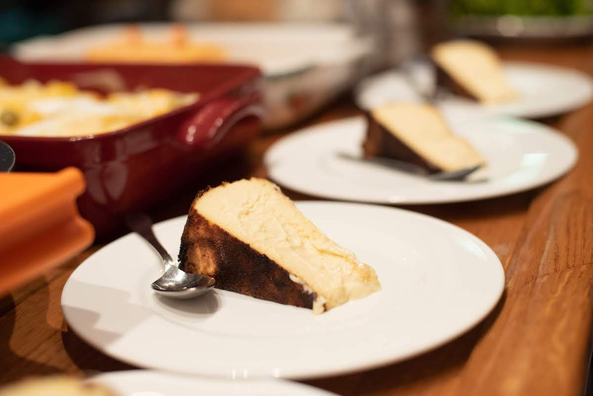Individual slices of crustless caramelized cheesecake on plates.