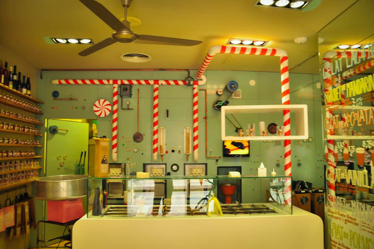 Interior of ice cream shop with whimsical candy cane-striped decor.