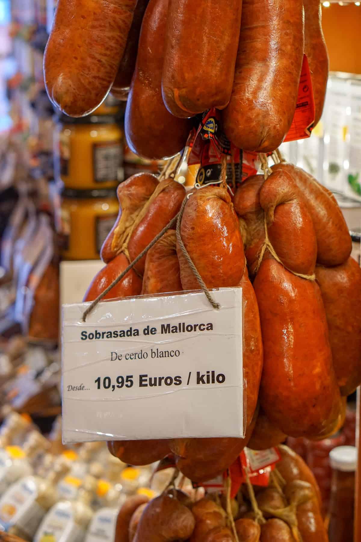 Mallorcan sobrassada hanging in a shop