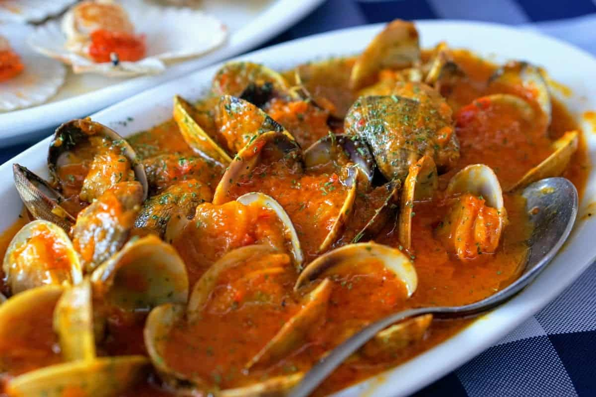 Clams in a bright red sauce