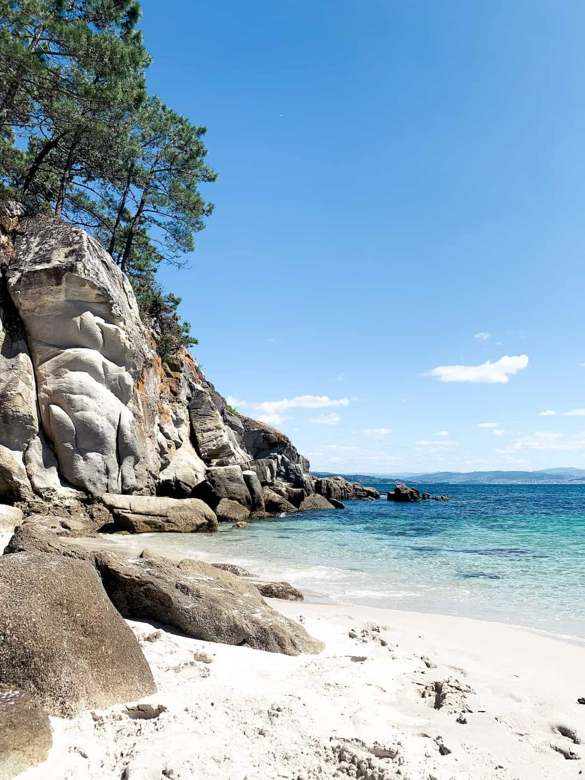 White sand beach surrounded by rocks