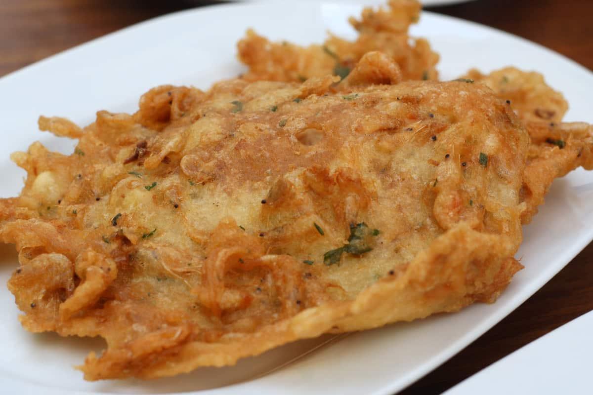 Fried shrimp fritter on a white plate